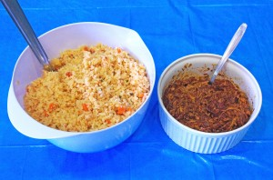 This photo shows a bowl of flavorful, golden colored rice next to another bowl of spicy Mole.