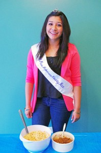 Stephanie Sanchez shows off her bowl of Excellent Rice at the Miss Arkansas Rice Contest