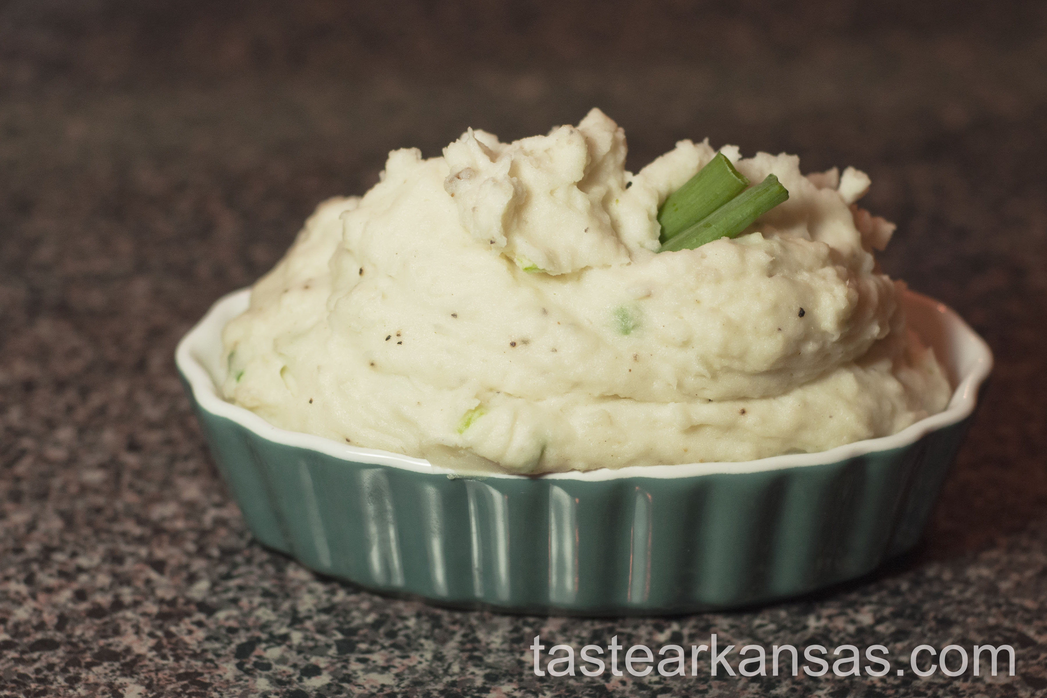 this image is of a robust portion of Garlic Chive Creamed Potatoes