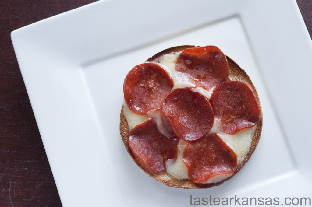 this photo is of a pizza crisp made from a sandwich thin, havarti cheese and turkey pepperoni
