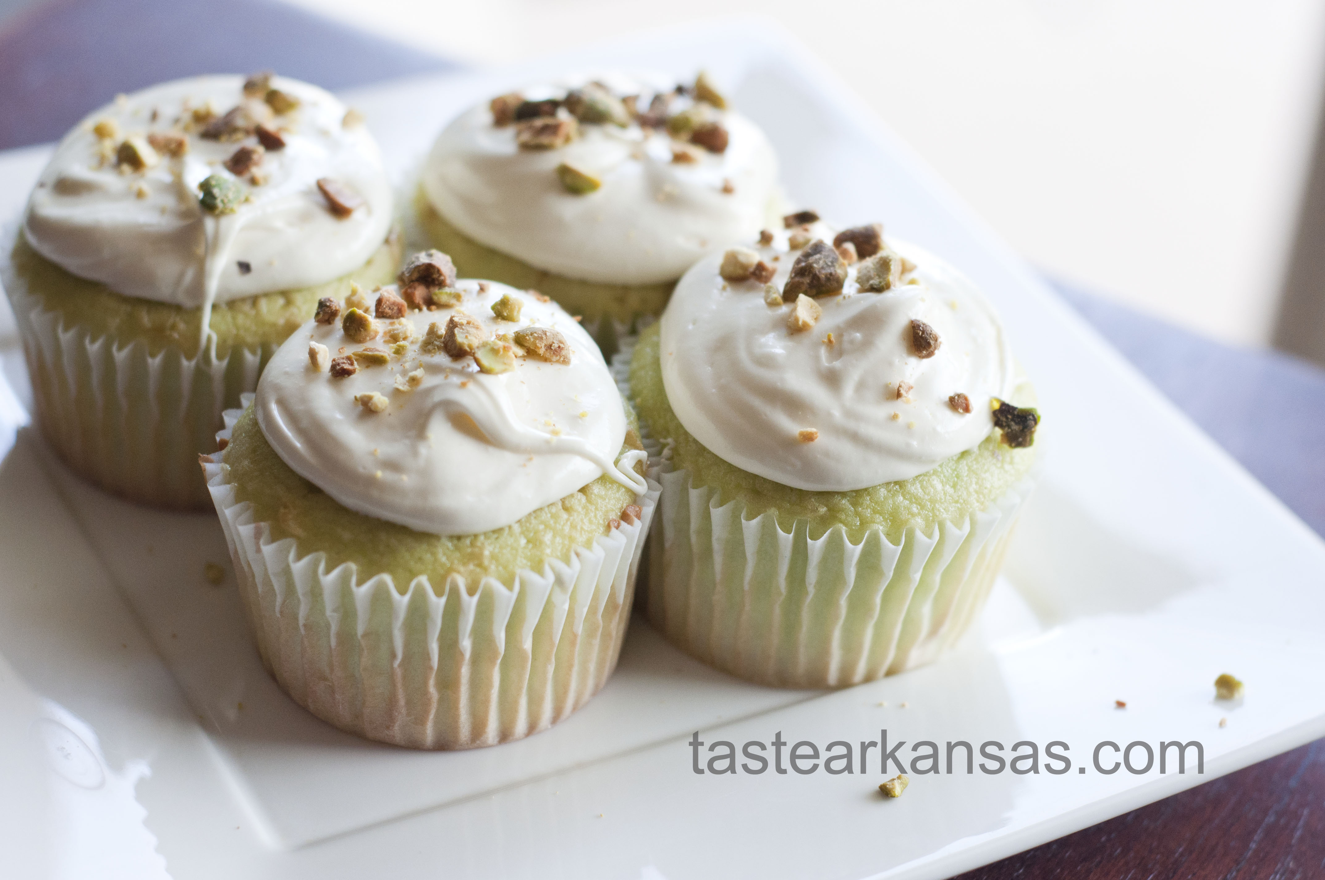 This image is of St. Patrick's Day Pistachio Cupcakes on a white plate