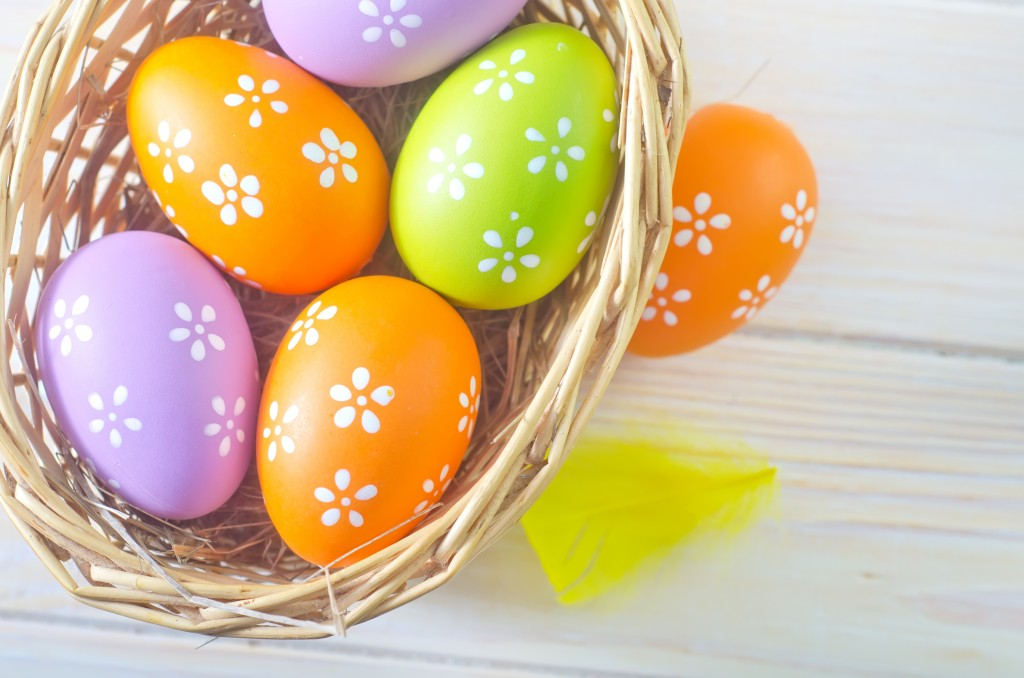 this photo is of a basket of colorfully decorated Easter eggs