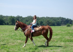 Daughter Katie Ella rides her horse which she competes in rodeos with.