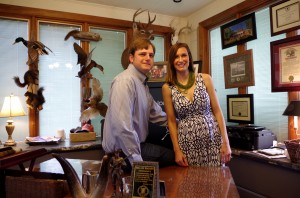 Nathan and Kristin in their office.