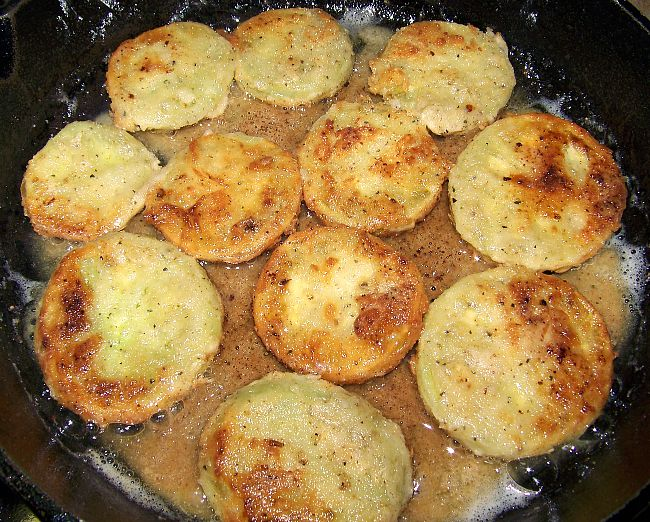 Fried green tomatoes in pan