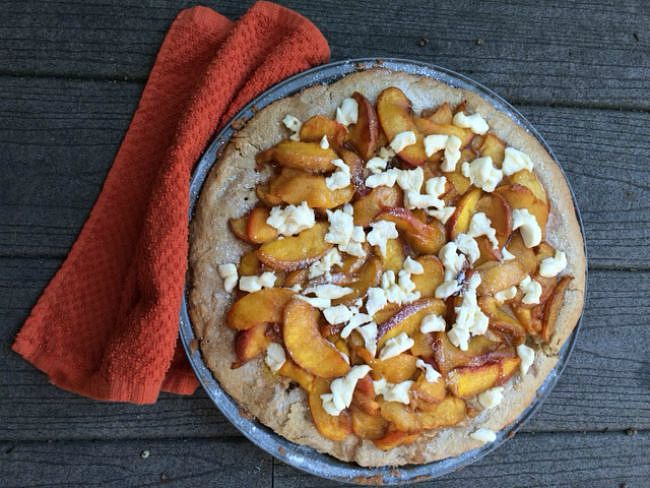 Peach pizza is served