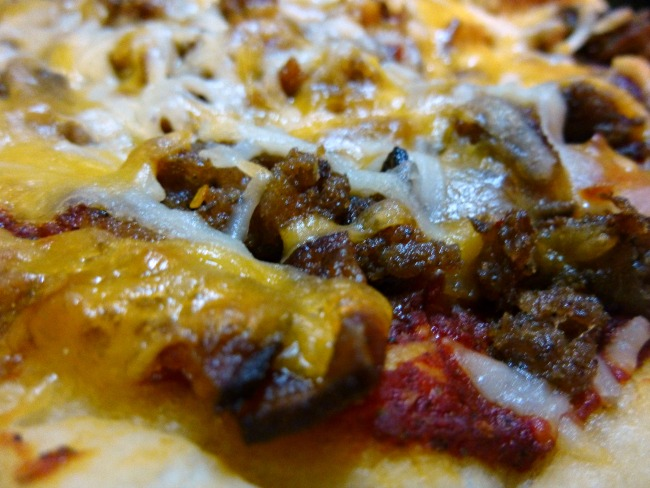 FB Taste Ark Mar Pork Lovers Skillet pizza closeup